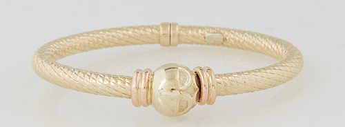 Vintage 14K Yellow Gold Hinged Bangle Bracelet, of ribbed form, one end with a flower stamped ball, Int. H.- 2 in., Int. W.- 2 1/2 in., Wt.- .45 Troy