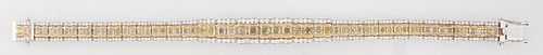 18K Yellow and White Gold Link Bracelet, each of the 28 graduated rectangular links with two cushion cut yellow diamonds, flanked by three small round