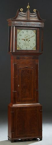 English Inlaid Carved Mahogany Calendar Grandfather Clock, 19th c., the pierced brass finial mounted broken arch crest over a stepped crown above a gl