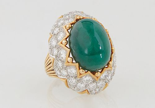 Lady's 18K Yellow Gold Dinner Ring, with an app. 11 ct. oval cabochon emerald within a gold crown mount over sloping sides with zigzag rows of round d