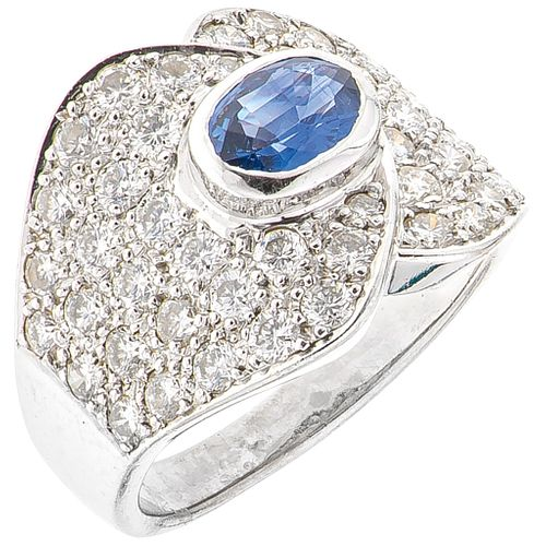 RING WITH SAPPHIRE AND DIAMONDS IN 18K WHITE GOLD 1 Oval cut sapphire ~0.70 ct and 46 Brilliant cut diamonds ~1.20 ct. Size: 6
