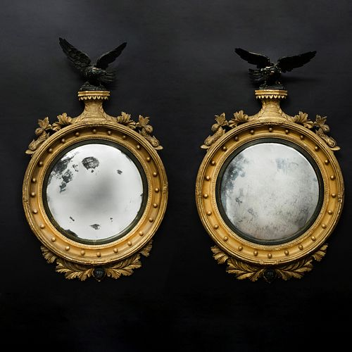 Fine Pair of Regency Giltwood and Ebonized Convex Mirrors