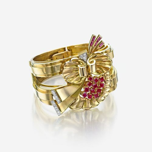 A Retro eighteen karat gold, ruby, and diamond bangle bracelet