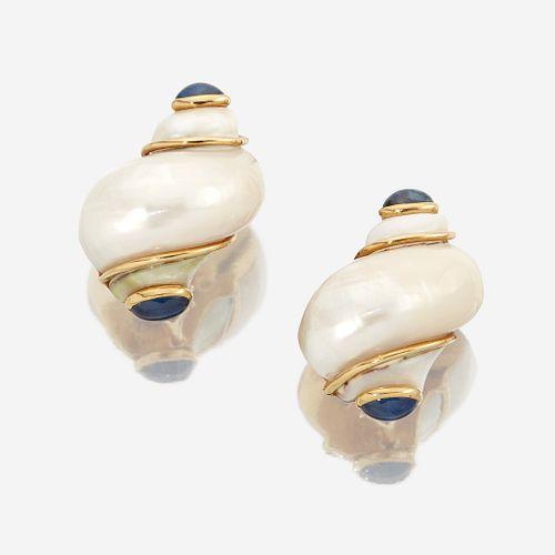 A pair of turbo shell, sapphire, and eighteen karat gold earclips, Seaman Schepps