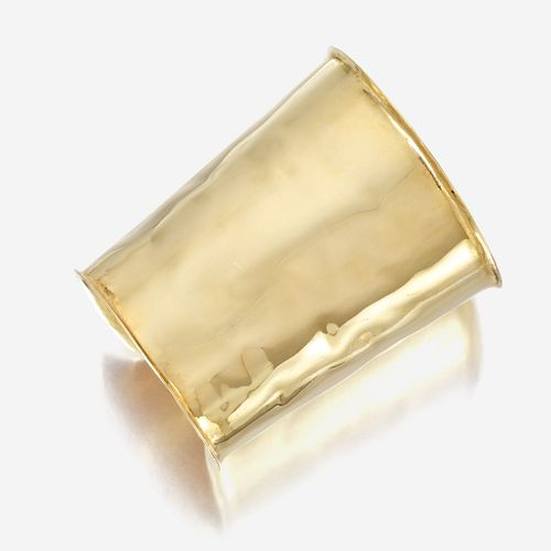 An eighteen karat gold cuff bracelet