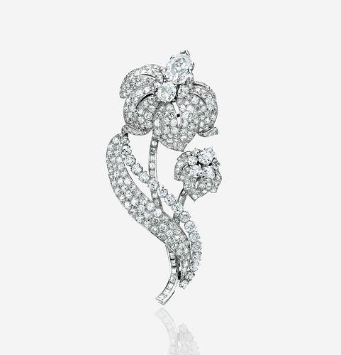 A diamond and platinum clip brooch, Cartier London