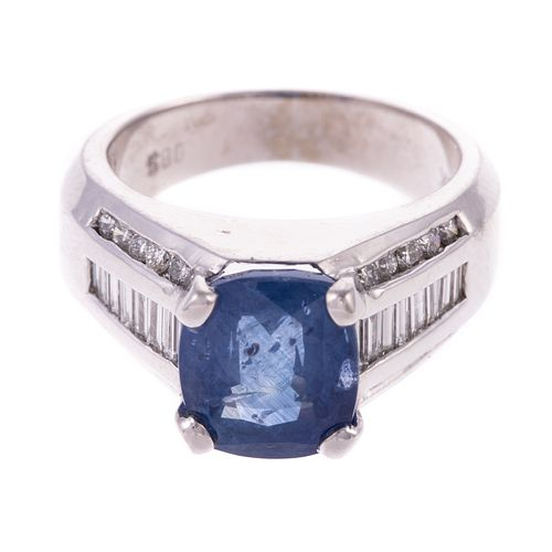 A 4.85 ct Sapphire & Diamond Ring in 18K