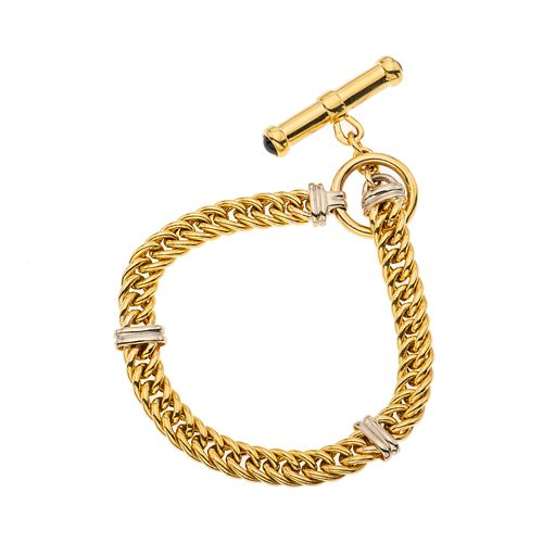 Pulsera en oro amarillo y blanco de 14k. Broche de perno. Peso: 18.0 g.
