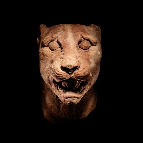 A Greek Marble Panther Head Height 8 x width 5 1/2 inches.