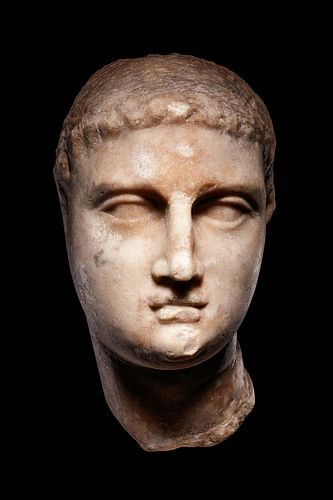A Greek Marble Portrait Head of Ptolemy III Height 7 3/4 inches.