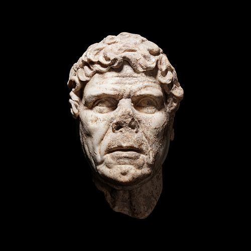 A Hellenistic Marble Portrait Head Height 12 inches.