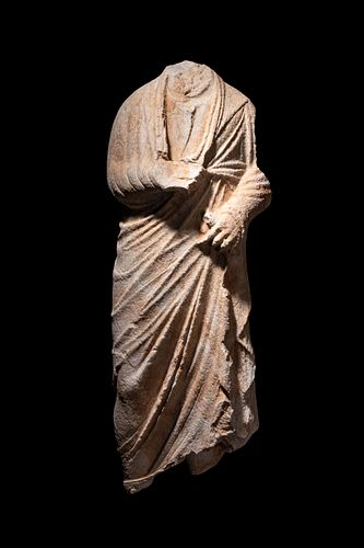 A Roman Marble Togatus Height 37 1/2 x width 14 inches.