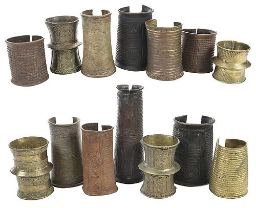 Group of 14 African Bronze Bangles and Cuffs