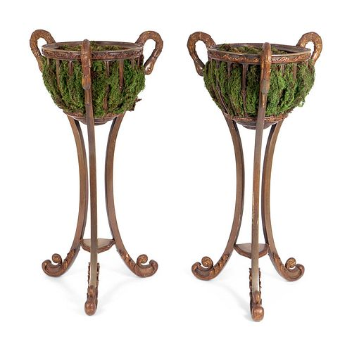 A Pair of Neoclassical Style Composition Jardinieres Height 48 x diameter of bowl 18 inches.