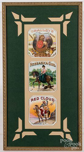 Three framed cigar labels
