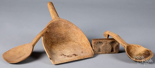 Three wooden scoops, together with a butterprint