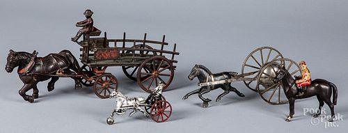 Four cast iron toys