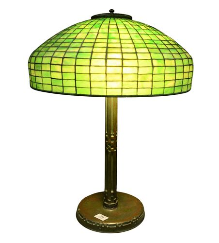 Tiffany Studios Leaded Green Glass Table Lamp, geometric pattern shade on Indian patinated bronze base, marked 'Tiffany, New York, 528' edge of shade