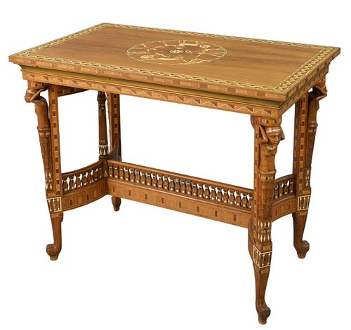 """Egyptian Revival Center Table, having carved female supports and claw feet, with various inlays, height 32 inches, top 24"""" x 39""""."""