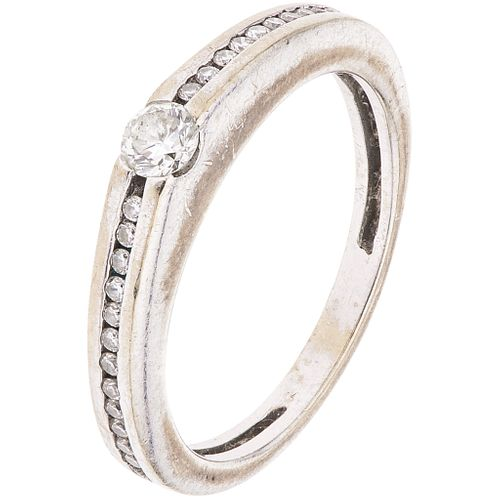RING WITH DIAMONDS IN 18K WHITE GOLD 25 Brilliant cut diamonds ~0.25 ct. Weight: 3.2 g. Size: 5 ¾