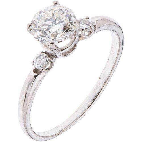 RING WITH DIAMONDS IN 14K WHITE GOLD 1 Brilliant cut diamonds ~1.20 ct Clarity: VS2 and 2 Swiss cut diamonds ~0.10 ct