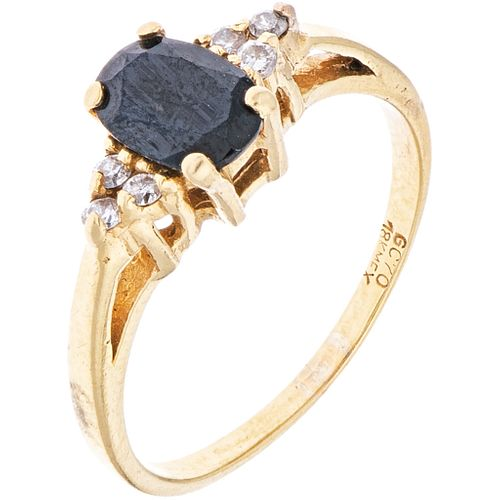 RING WITH SAPPHIRE AND DIAMONDS IN 18K YELLOW GOLD 1 Oval cut sapphire ~0.40ct and 6 Diamonds (different cuts)~0.09ct. Size: 7¼