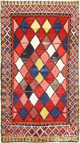PRIMITIVE VINTAGE PERSIAN GABBEH. 7 ft 6 in x 4 ft 3 in (2.29 m x 1.3 m).