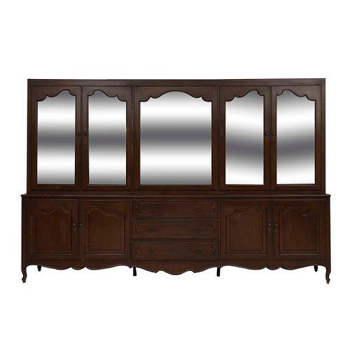 Vitrina. SXX. Talla en madera. A 2 cuerpos. Con 8 puertas abatibles, 4 con cristal biselado y 3 cajones. 224 x 331 x 60 cm