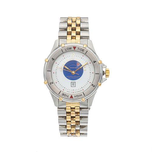 Reloj Krieger en acero y chapa Ref  882 Movimiento: cuarzo. Con fechador, instructivo y garantía.