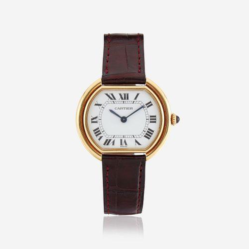 An eighteen karat gold watch, Cartier
