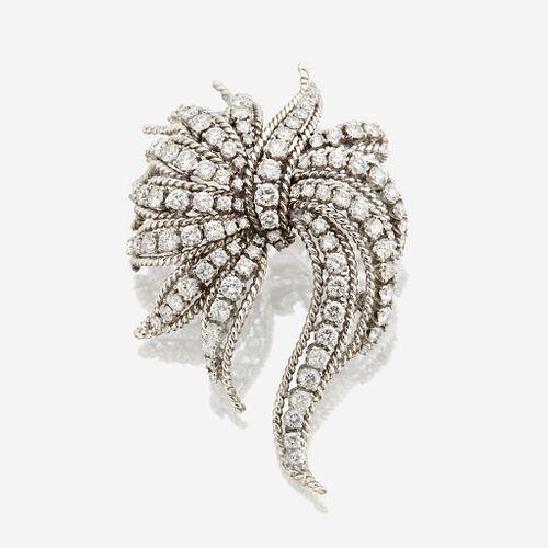 A diamond and eighteen karat white gold brooch
