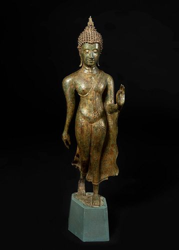 Sukhothai Walking Buddha, Sukhothai Period, 14th-15th centuries. Bronze with remains of polychrome. Wooden base.