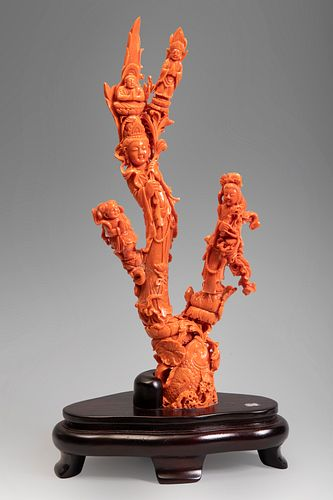 Buddhist group with Kuan Kin. China, 20th century. In coral with three branches. Wooden base.