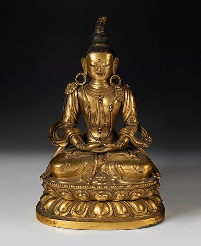 Amitayus Buddha. Tibet, 17th-18th century. Mercury gilt bronze, with semi-precious stones.