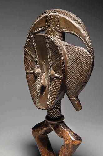 Kota Obamba reliquary figure. Kota people, Gabon, 19th century. Wood covered with copper plates.