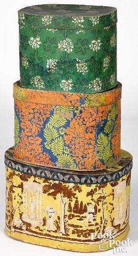Three wallpaper hat boxes, mid 19th c.