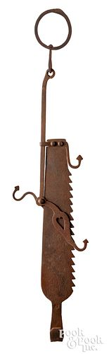 Wrought iron trammel, dated 1733, with engraved tu