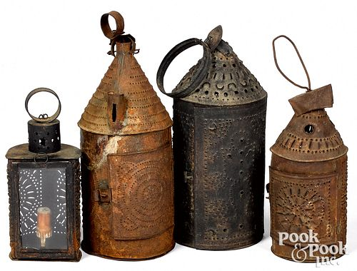 """Four punched tin lanterns, 19th c., tallest - 15""""."""