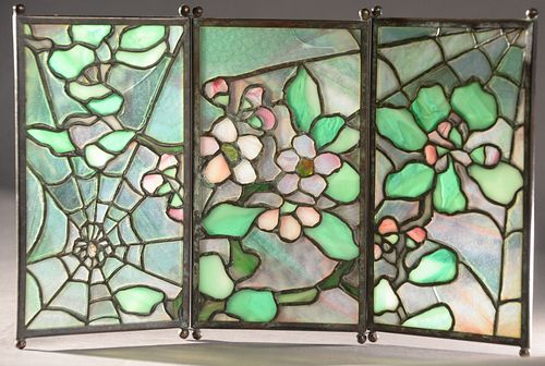 """Tiffany Studios """"Spider"""" Tea Screen, having three leaded glass panels with patinated bronze having apple blossom with spider web on ball feet, height"""