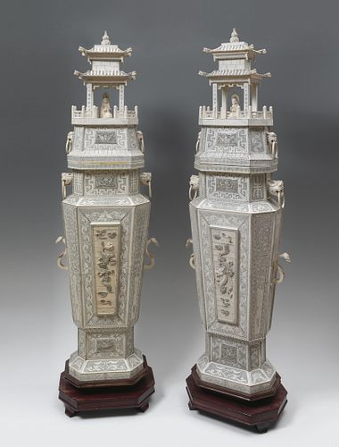 Pair of pagodas. China, second half of the 20th century. Carved ivory. Lower structure with a wooden core.