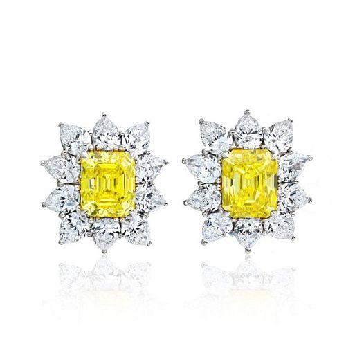 PLATINUM 8.44 CARATS FANCY VIVID YELLOW DIAMOND