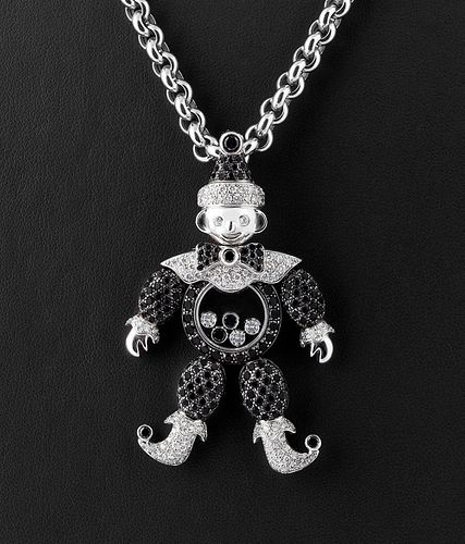 """CHOPARD """"Happy Diamonds"""" chain and pendant with movable black and colorless diamonds, serial number 79/2246/50-20 2785232."""