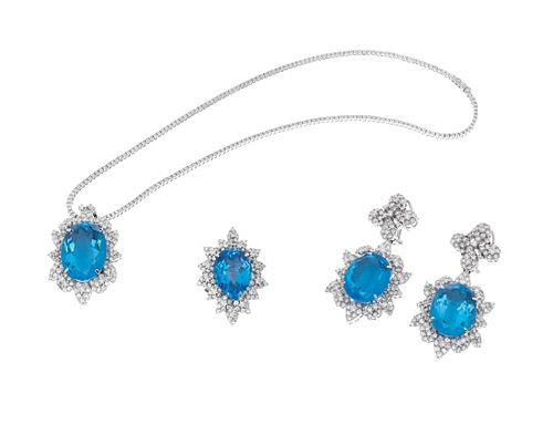 Set of choker, pair of earrings and ring in 18kt white gold.