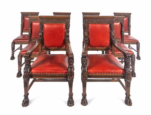 A Set of Eight R.J. Horner Carved Oak Man of the Mountain Dining Chairs