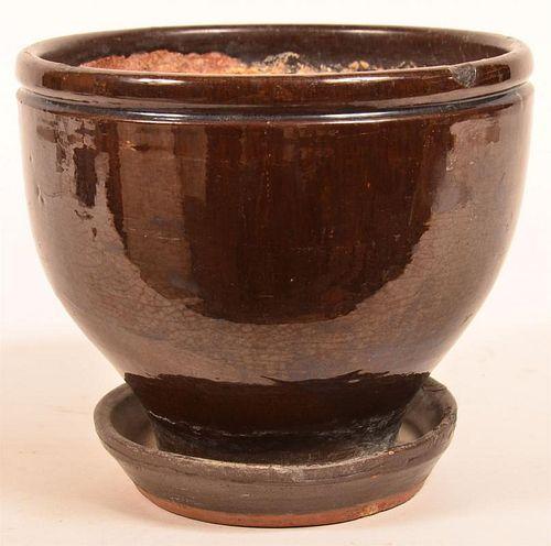 Mottle Glazed Redware Pottery Flower Pot.
