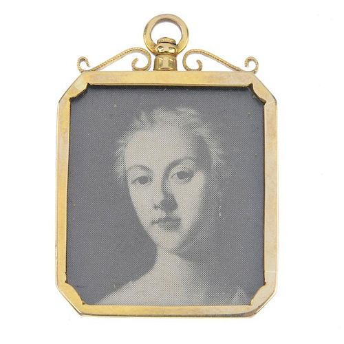A late 19th century 9ct gold photograph pendant. Of rectangular-shape outline, the engraved monogram