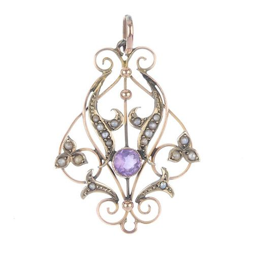 An early 20th century 9ct gold amethyst and split pearl pendant. Designed as openwork scrolls, with