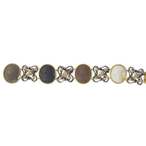 A lava cameo bracelet. Comprising four oval-shape lava cameo panels, of varying tones depicting gent