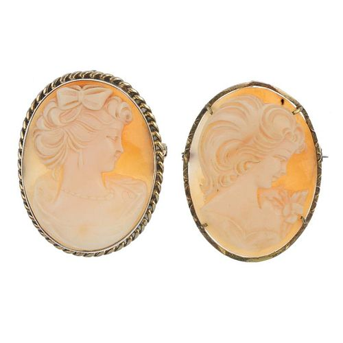 Two shell cameo brooches. Both of oval-shape outline, the shell cameos carved to depict the side pro
