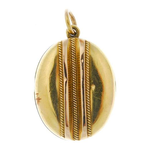 A late 19th century gold locket. Of oval outline, the embossed rope-twist and raised line detail, to
